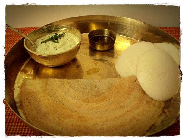 dosa and idli served with podi and chutney